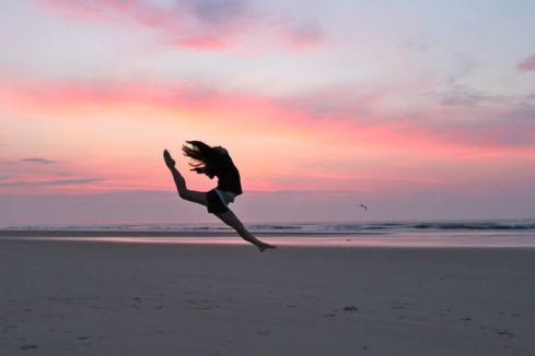 Dance leap on the beach